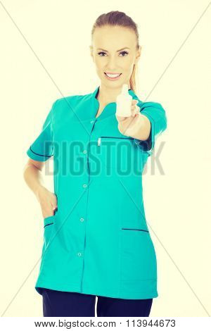 Nurse in uniform with hydrogen peroxide.