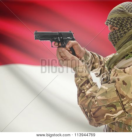 Male In With Gun In Hand And National Flag On Background - Indonesia