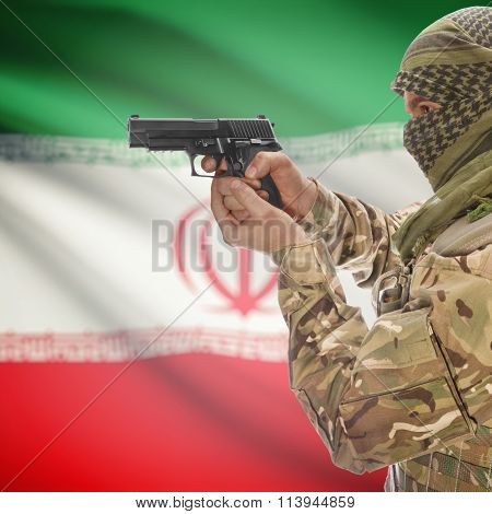 Male In With Gun In Hand And National Flag On Background - Iran