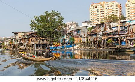 HO CHI MINH, VIETNAM - JAN 10, 2015: Views of the city's Slums from Boat. Is located in the South of Vietnam, is the country's largest city, population 8 million.