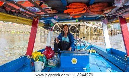 HO CHI MINH, VIETNAM - JAN 11, 2015: Local woman driver a boat. Traffic between Ho Chi Minh and southern provinces has steadily increased over years, receive 100,000 waterway vehicles every year.
