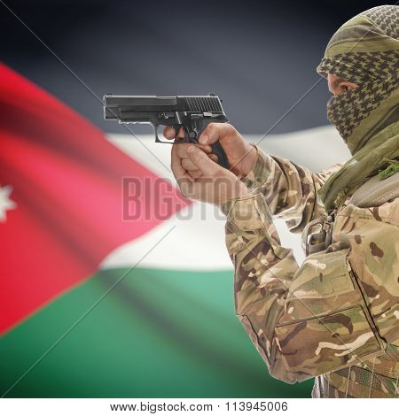 Male With Gun In Hand And National Flag On Background - Jordan