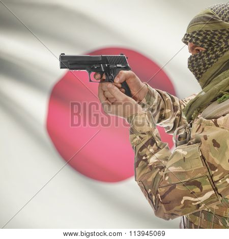 Male With Gun In Hand And National Flag On Background - Japan