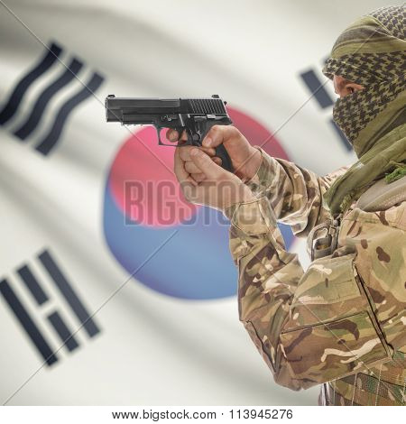 Male With Gun In Hand And National Flag On Background - South Korea
