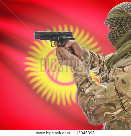 Male With Gun In Hand And National Flag On Background - Kyrgyzstan