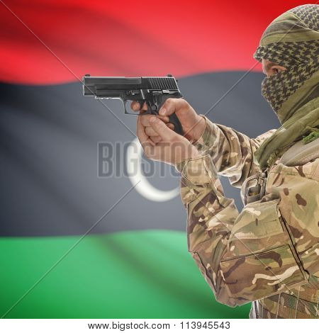 Male With Gun In Hand And National Flag On Background - Libya