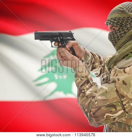 Male In With Gun In Hand And National Flag On Background - Lebanon