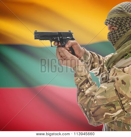 Male In With Gun In Hand And National Flag On Background - Lithuania