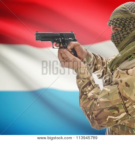 Male With Gun In Hand And National Flag On Background - Luxembourg