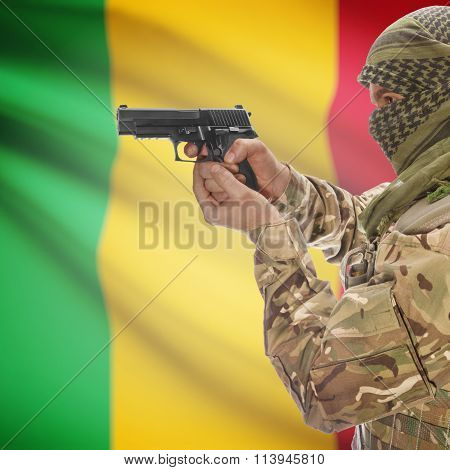 Male In With Gun In Hand And National Flag On Background - Mali