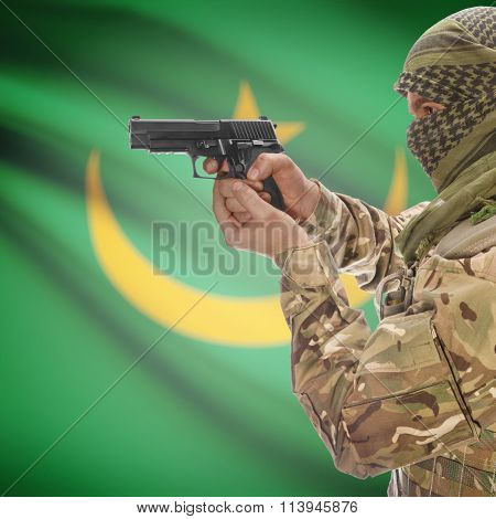 Male In With Gun In Hand And National Flag On Background - Mauritania