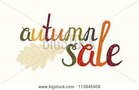 Autumn sale inscription with oak leaf.