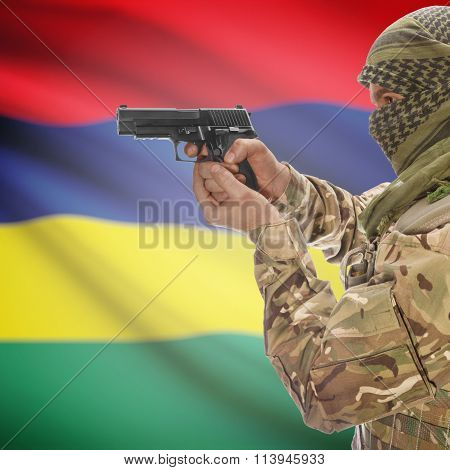 Male In With Gun In Hand And National Flag On Background - Mauritius