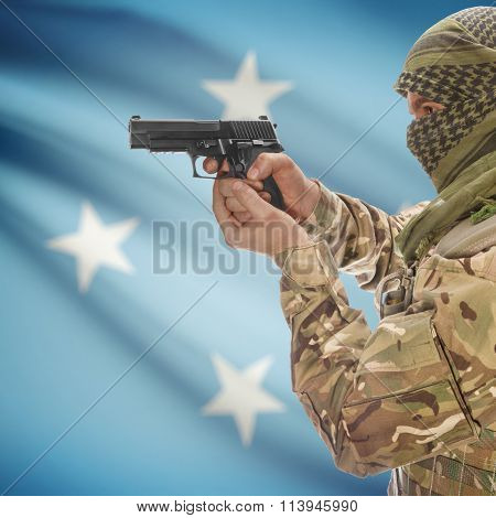 Male In With Gun In Hand And National Flag On Background - Micronesia