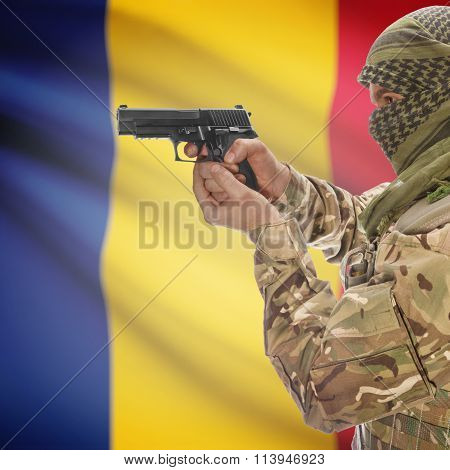 Male With Gun In Hand And National Flag On Background - Romania