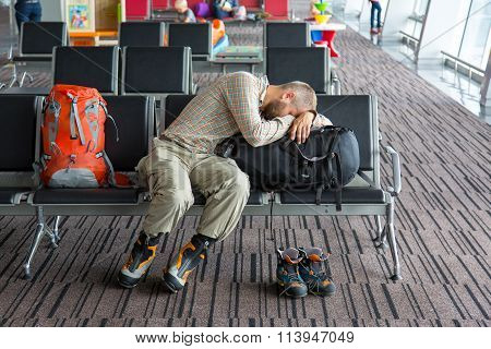 Airport lounge and people waiting for boarding