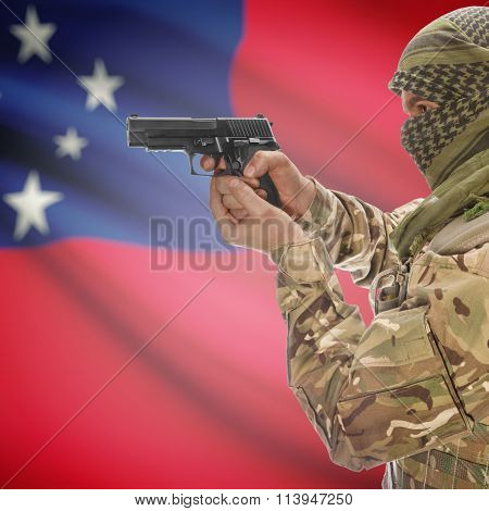 Male In With Gun In Hand And National Flag On Background - Samoa