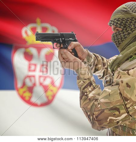 Male With Gun In Hand And National Flag On Background - Serbia
