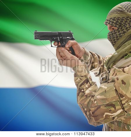 Male In With Gun In Hand And National Flag On Background - Sierra Leone
