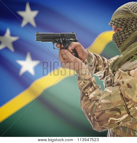 Male In With Gun In Hand And National Flag On Background - Solomon Islands