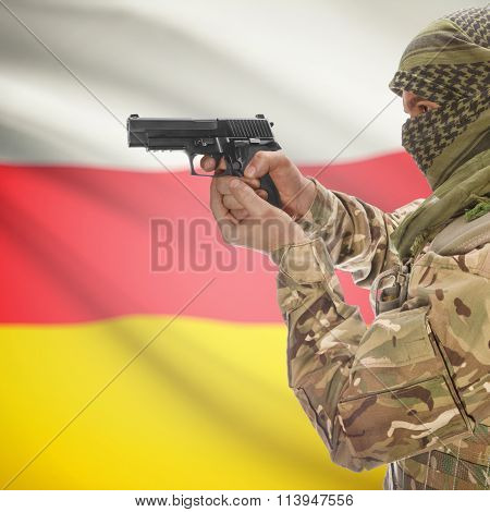 Male In With Gun In Hand And National Flag On Background - South Ossetia