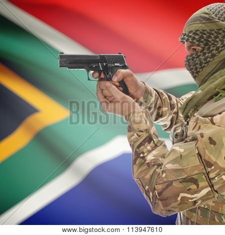 Male With Gun In Hand And National Flag On Background - South Africa