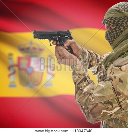 Male With Gun In Hand And National Flag On Background - Spain