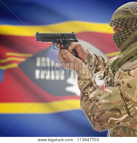 Male In With Gun In Hand And National Flag On Background - Swaziland