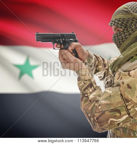 Male With Gun In Hand And National Flag On Background - Syria