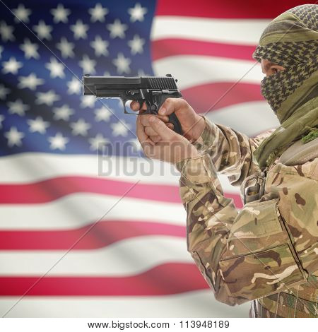 Male With Gun In Hand And National Flag On Background - United States