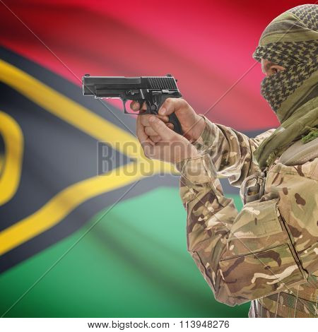Male In With Gun In Hand And National Flag On Background - Vanuatu