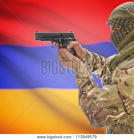 Male In With Gun In Hand And National Flag On Background - Armenia