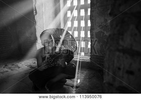 Unidentified Buddhism neophyte read a book in Buddihist temple