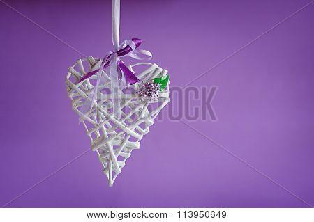 Valentine Love White Heart Handemade On Purple Background. Valentines Day Card Concept