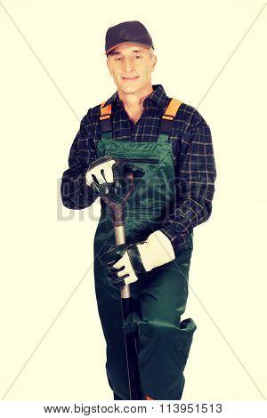 Mature gardener with a spade