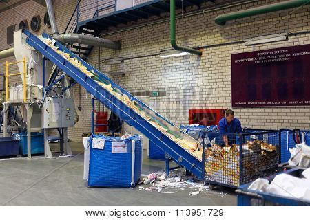 MOSCOW, RUSSIA - NOV 29, 2014: Conveyor paper recycling system in Typographic complex Pushkinskaya Square