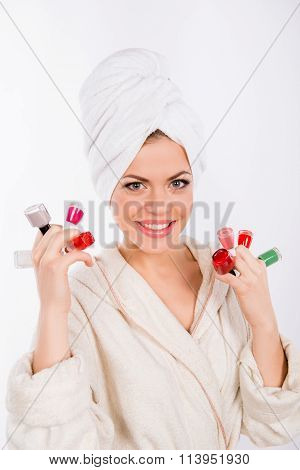 Pretty Woman Holding Different Nail Laquers