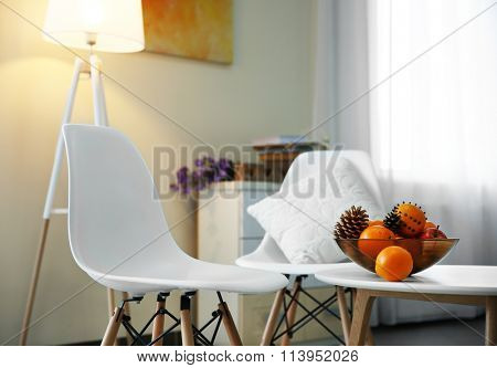 Room design with white furniture and floor lamp over beige wall
