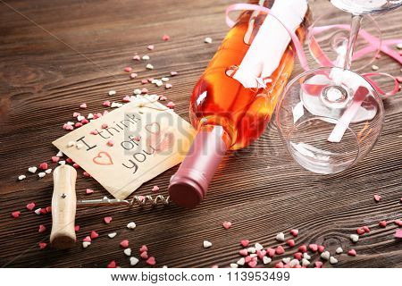 One love, one life concept - wine bottle and glasses with hearts around
