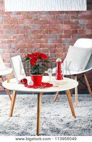 Modern room interior with Christmas flower poinsettia