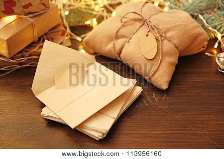 Christmas envelope with pullover gift on a table