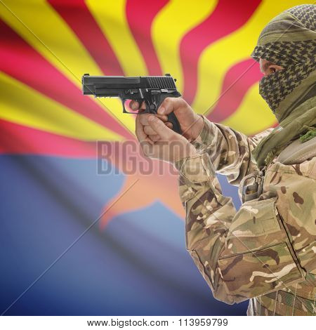 Male In With Gun In Hand And Flag On Background - Arizona
