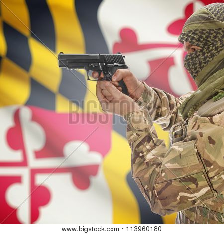 Male In With Gun In Hand And Flag On Background - Maryland