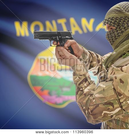 Male In With Gun In Hand And Flag On Background - Montana