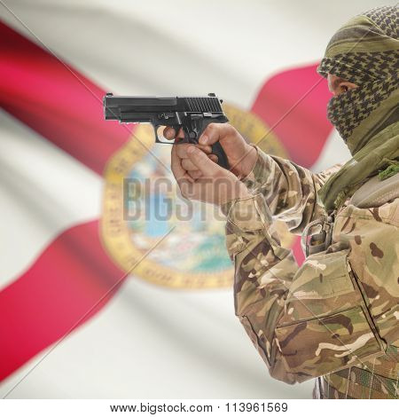 Male With Gun In Hand And Flag On Background - Florida