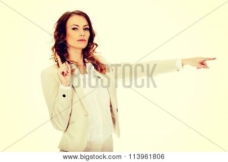 Attractive businesswoman pointing her finger.