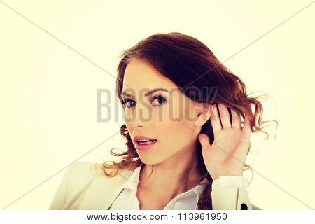 Beautiful businesswoman overhears.
