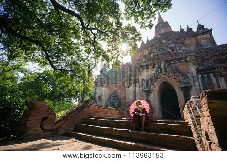 novice monk read the book in front of Sulamani Pagodas. Bagan