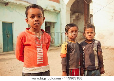 Unidentified Poor Children Having Fun On Rural Street Of Indian Town