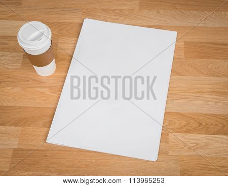 Blank Newspaper with empty space and coffee cup mock up on wood background